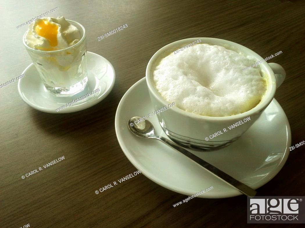 Stock Photo: In Limburg, most cafes serve your cappuccino with a little whipped cream and a dollop of Advocaat (a liquer made from eggs).