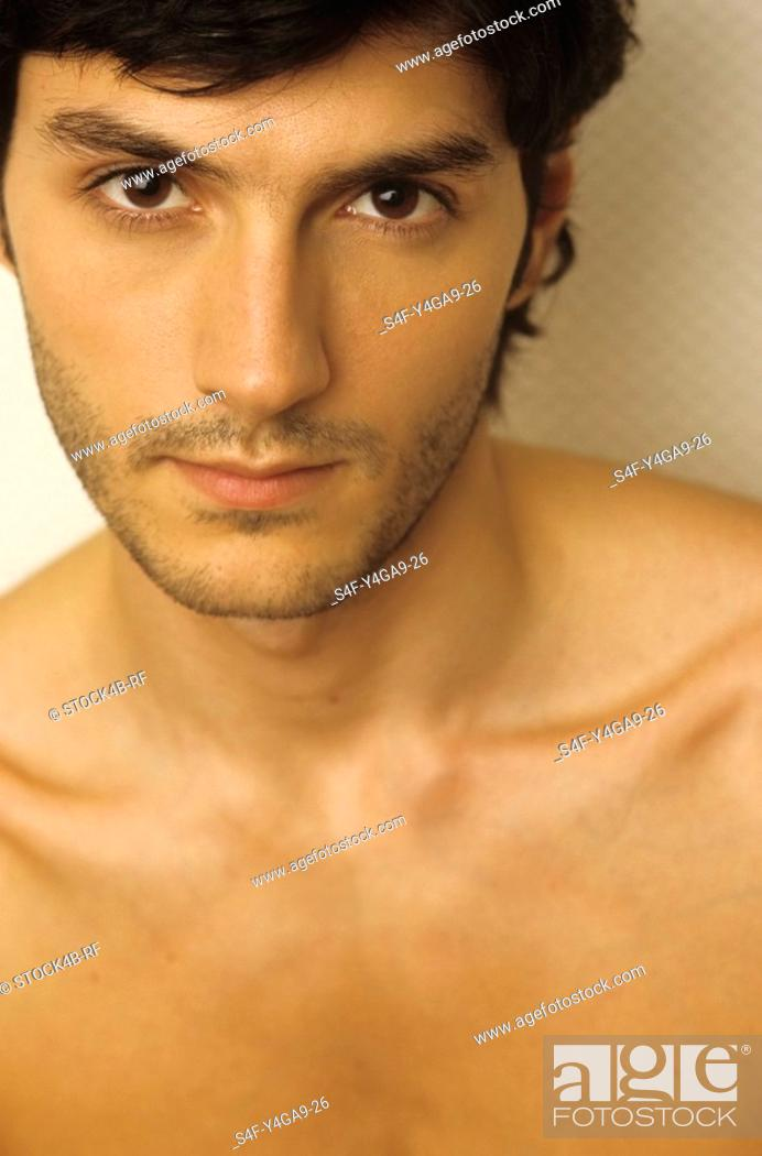 Stock Photo: Portrait of a Darkhaired Man - Look - Allurement - Facial Expression.