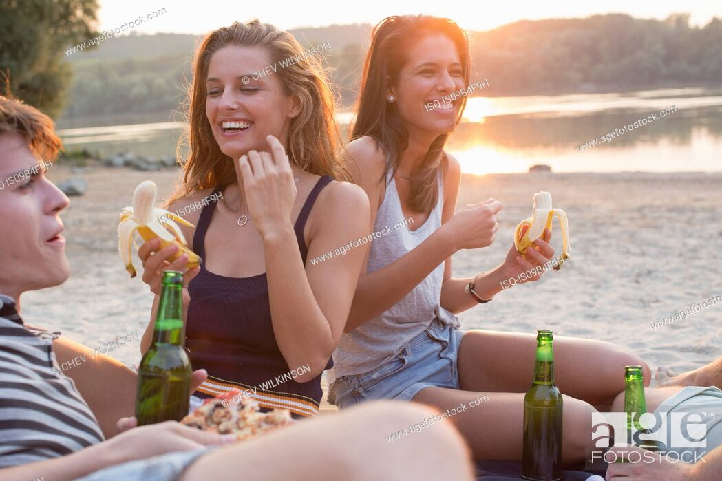 Stock Photo: Group of friends drinking, enjoying beach party.