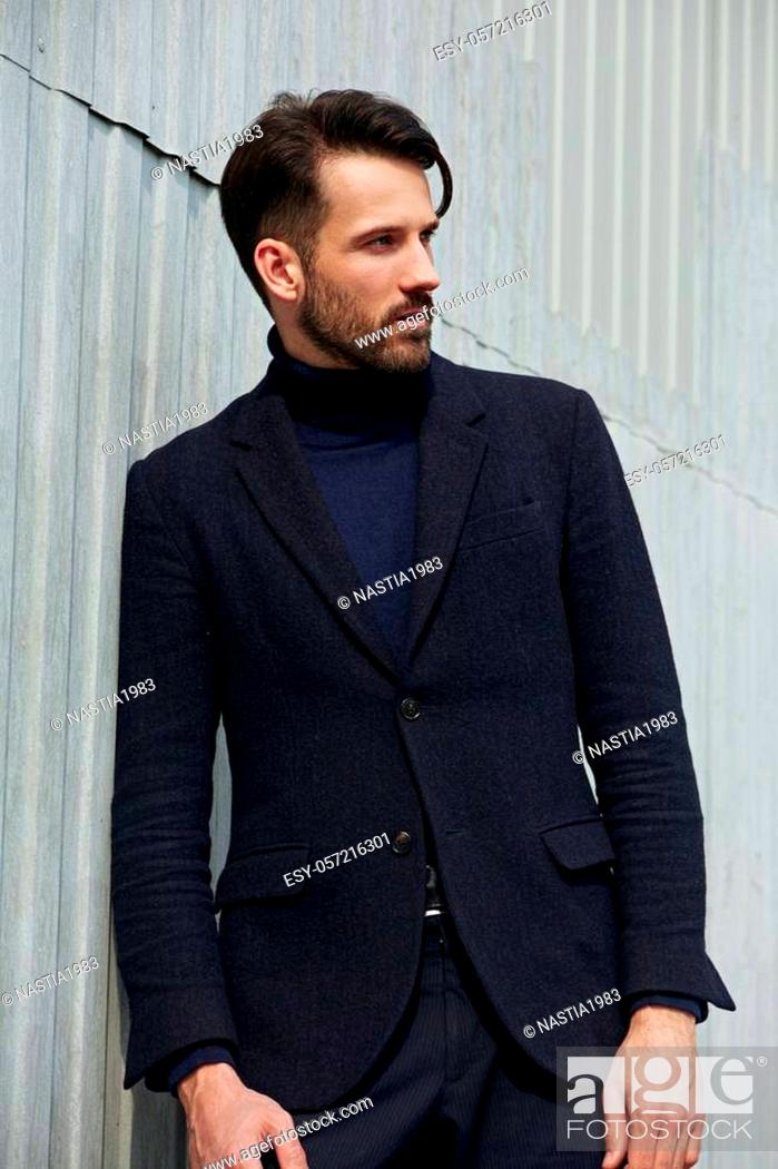 Stock Photo: Fashion beard style business handsome man posing in style clothing on street wall outdoors background. Closeup portrait.