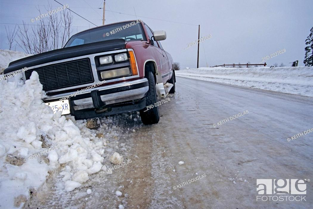 Stock Photo: Pickup truck in ditch after sliding off icy road, Smithers, British Columbia.