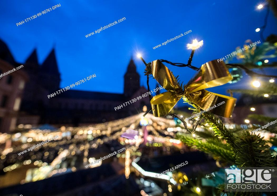 Stock Photo: A Christmas tree shines in the night during the opening of the Christmas market in Mainz, Germany, 30 November 2017. The Christmas market is open from 30.