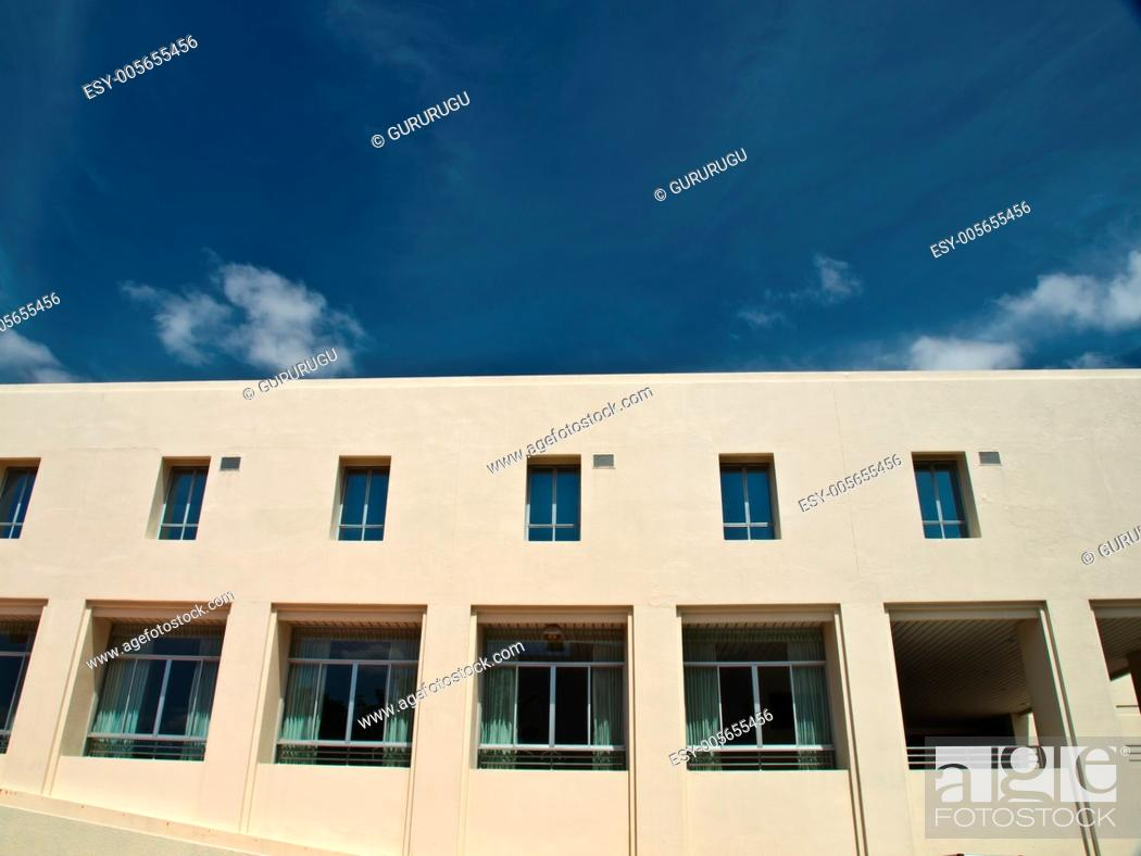 Stock Photo: Facade windows of office building on blue sky.