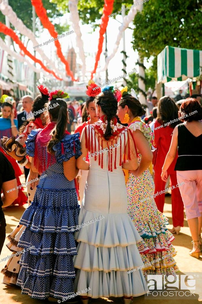 Stock Photo: Women wearing a flamenco style dress in the Seville Spring Fair, Seville, Andalusia, Spain.
