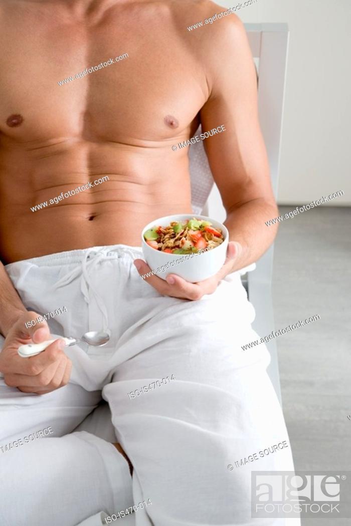 Stock Photo: Man with breakfast.