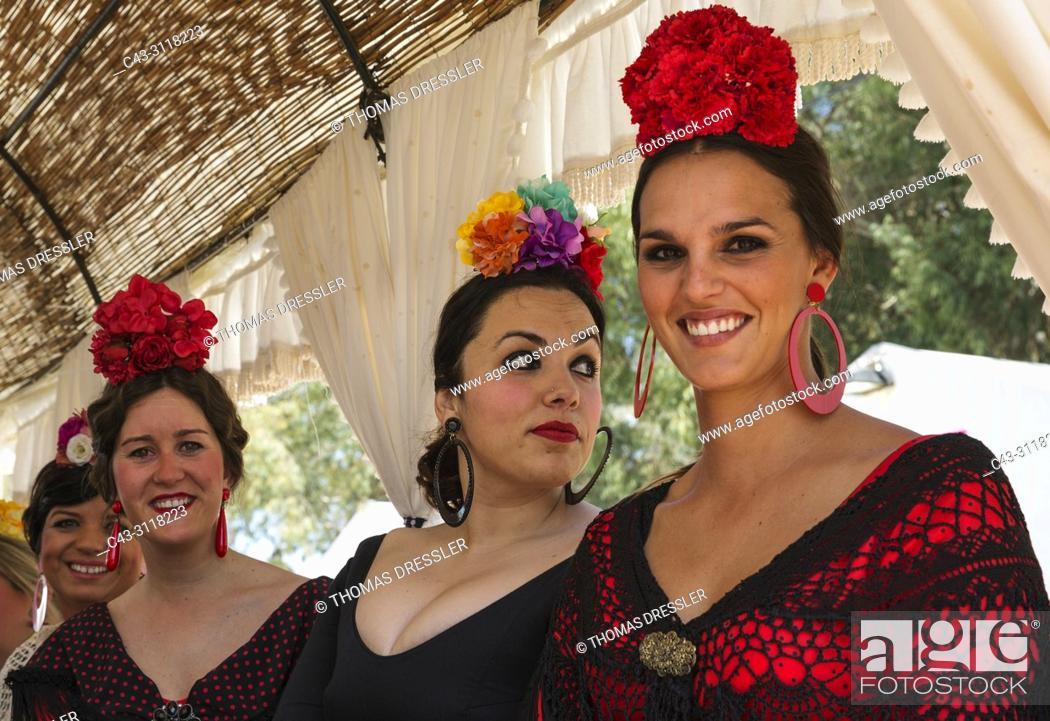 Stock Photo: Women wearing beautifully coloured gypsy dresses during the annual Pentecost pilgrimage of El Rocio. Huelva province, Andalusia, Spain.