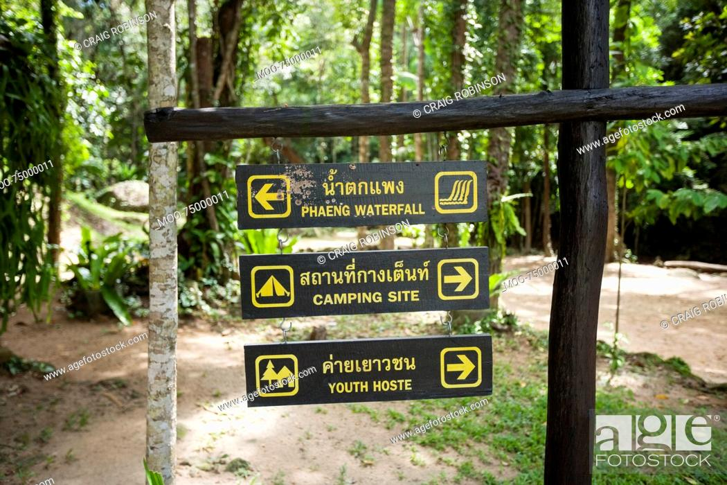 Stock Photo: Place signs hanging on signpost, Koh Pha Ngan, Thailand.