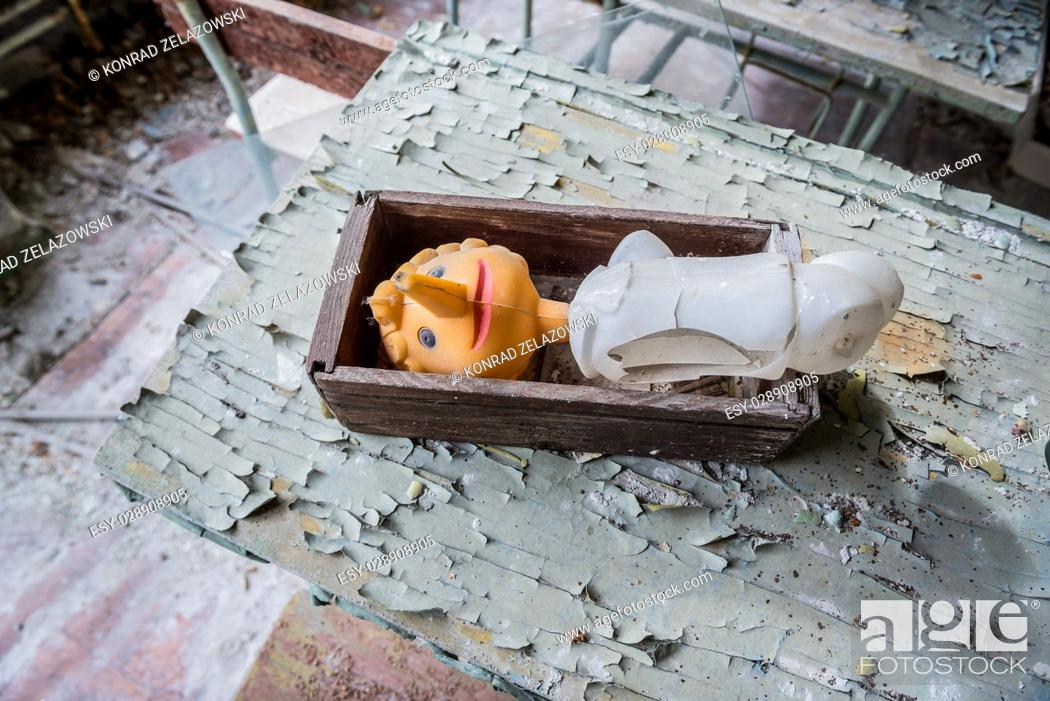 Stock Photo: Plastic toy in High school No 2 in Pripyat ghost city of Chernobyl Nuclear Power Plant Zone of Alienation around nuclear reactor disaster in Ukraine.