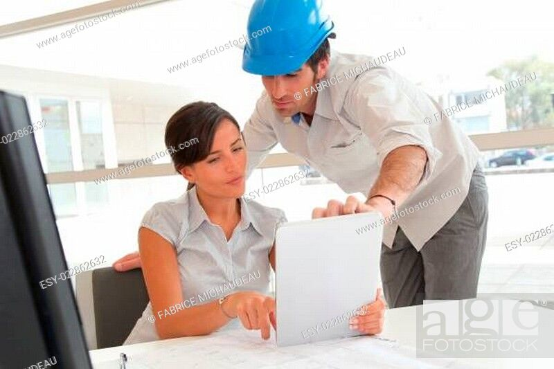 Stock Photo: Architects working in office with electronic tablet.