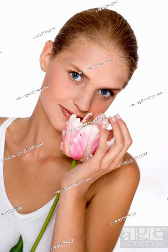 Stock Photo: young woman with rose tulip.
