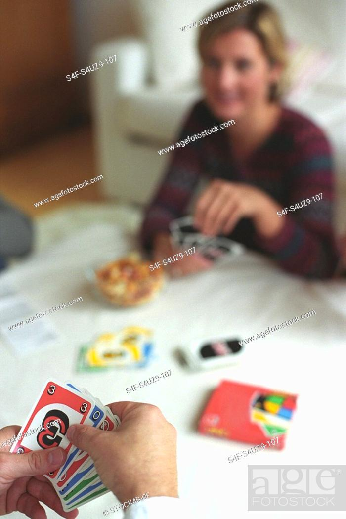 Stock Photo: People playing Cards.