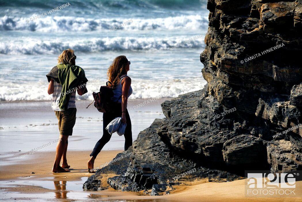 Imagen: Young couple on the beach, Praia da Cordoama, Cordoama beach, near Vila Do Bispo, close to Sagres, Parque Natural do Sudoeste Alentejano e Costa Vicentina.