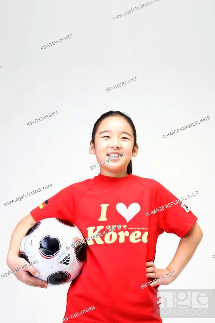 Stock Photo: girl holing soccer ball.