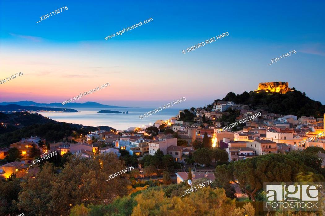 Stock Photo: Begur village and castle at dusk with Medes Islands L'Estartit at the background Costa Brava Baix Empordà Catalunya Spain.