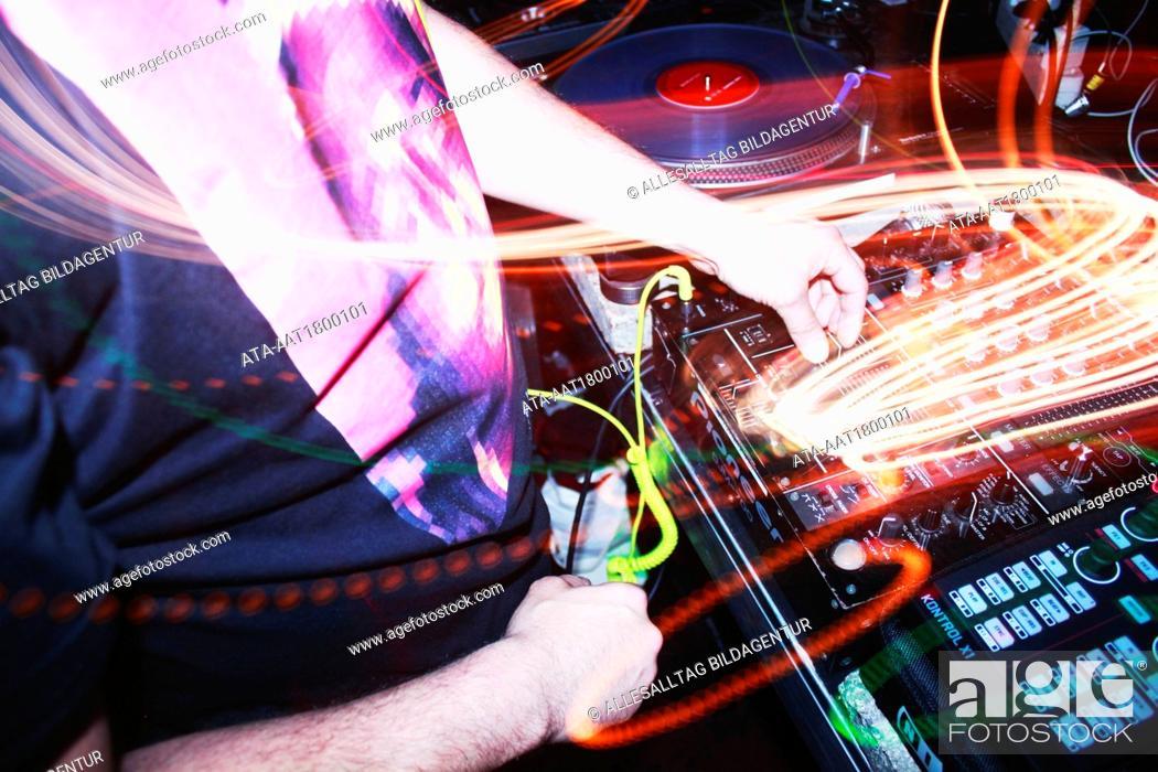 Stock Photo: DJ at the mixing desk.