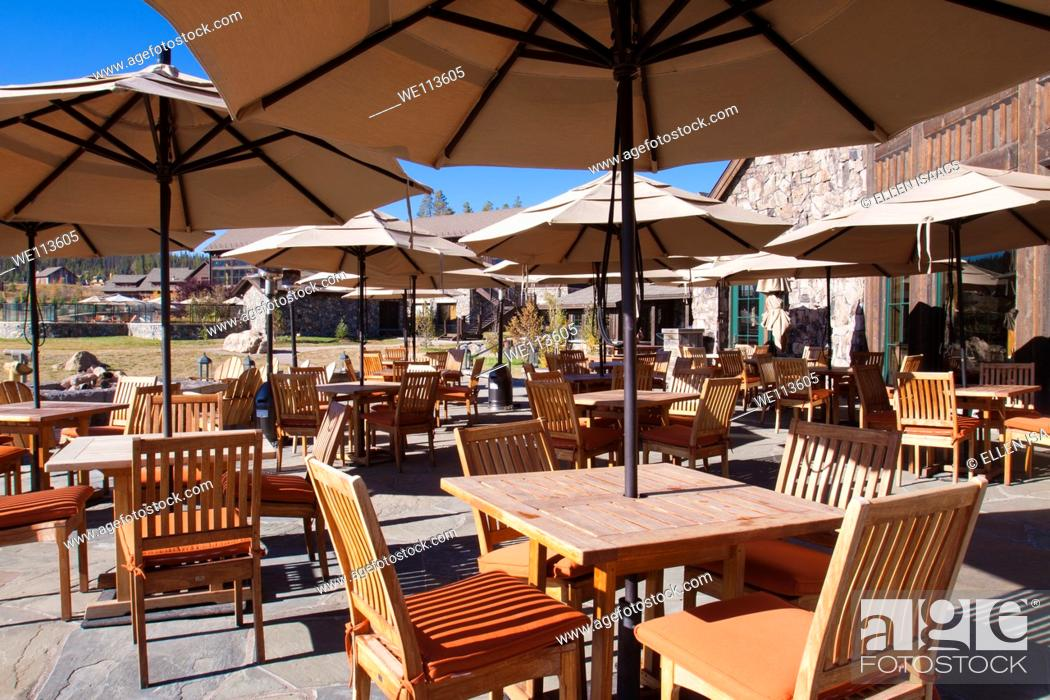 Outdoor Patio Dining At A Mountain Resort Lodge With Umbrellas Over Wood Tables And Chairs Stock Photo Picture And Royalty Free Image Pic We113605 Agefotostock