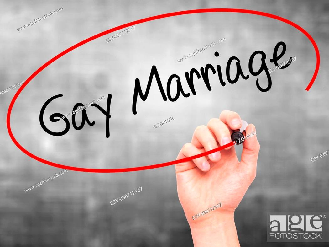 Stock Photo: Man Hand writing Gay Marriage with black marker on visual screen.