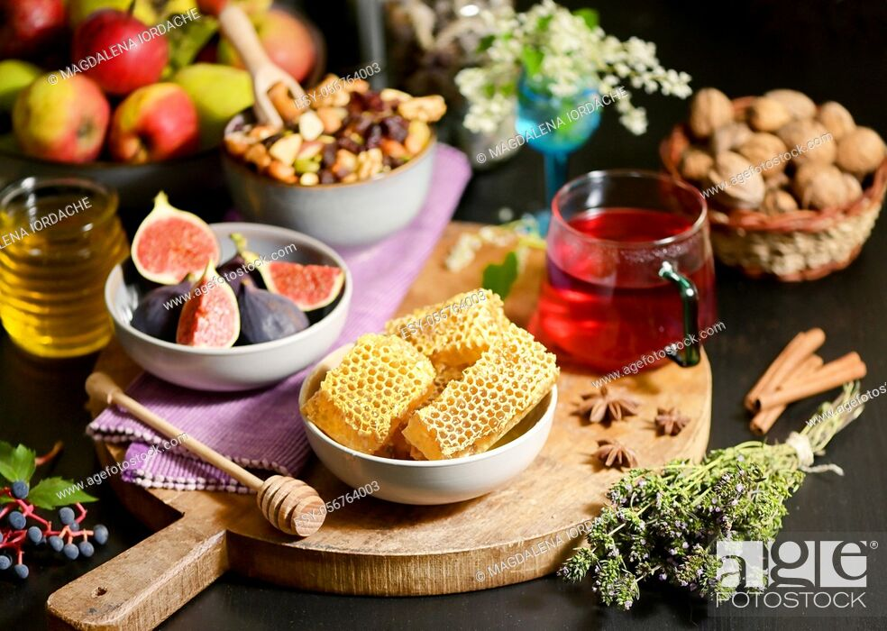 Stock Photo: Honey, Honeycomb, Tea, Dried Fruits and Figs on Autumn Table.