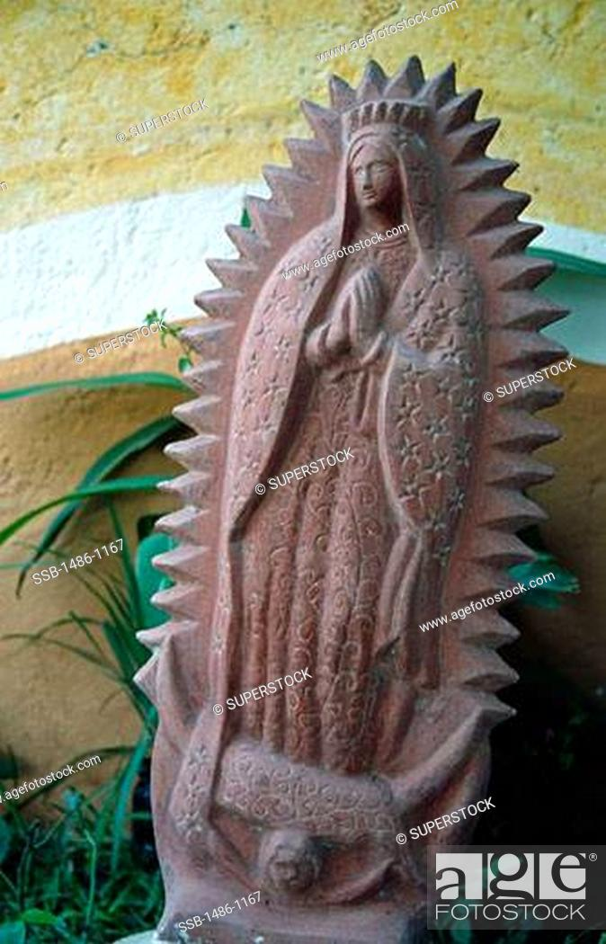Stock Photo: Close-up of a statue, Virgin of Guadalupe, Zihuatanejo, Guerrero, Mexico.