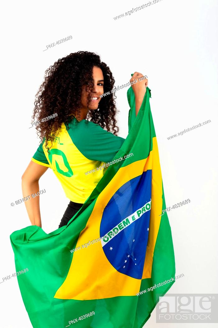 Stock Photo: Portrait of a young supporter of the Brazil team wearing the national flag.