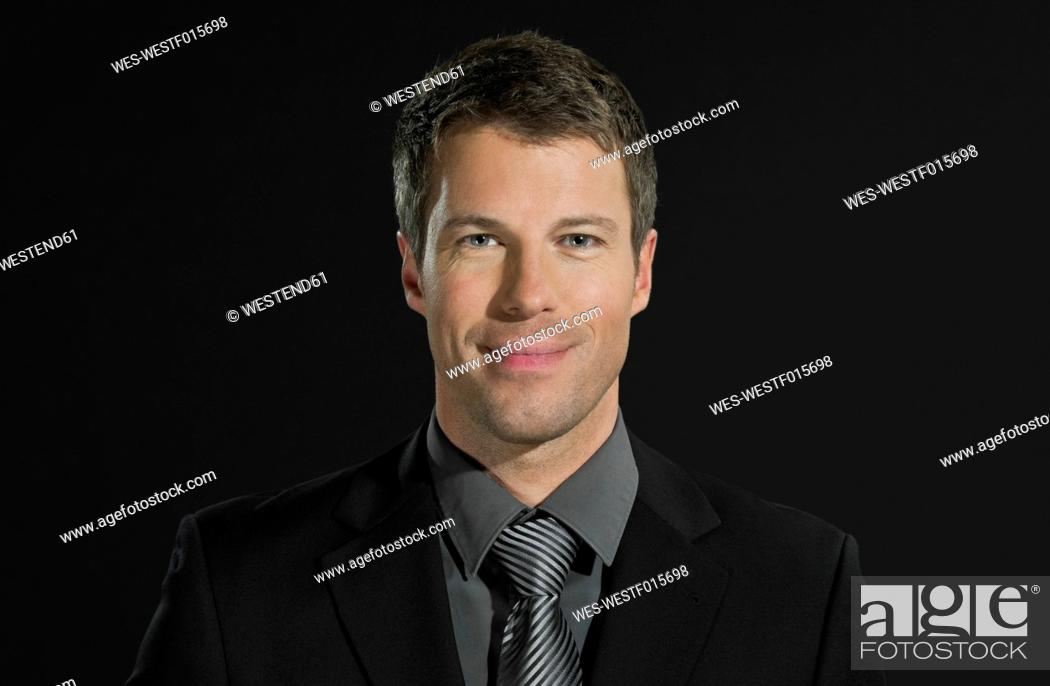 Stock Photo: Mid adult man smiling, portrait.