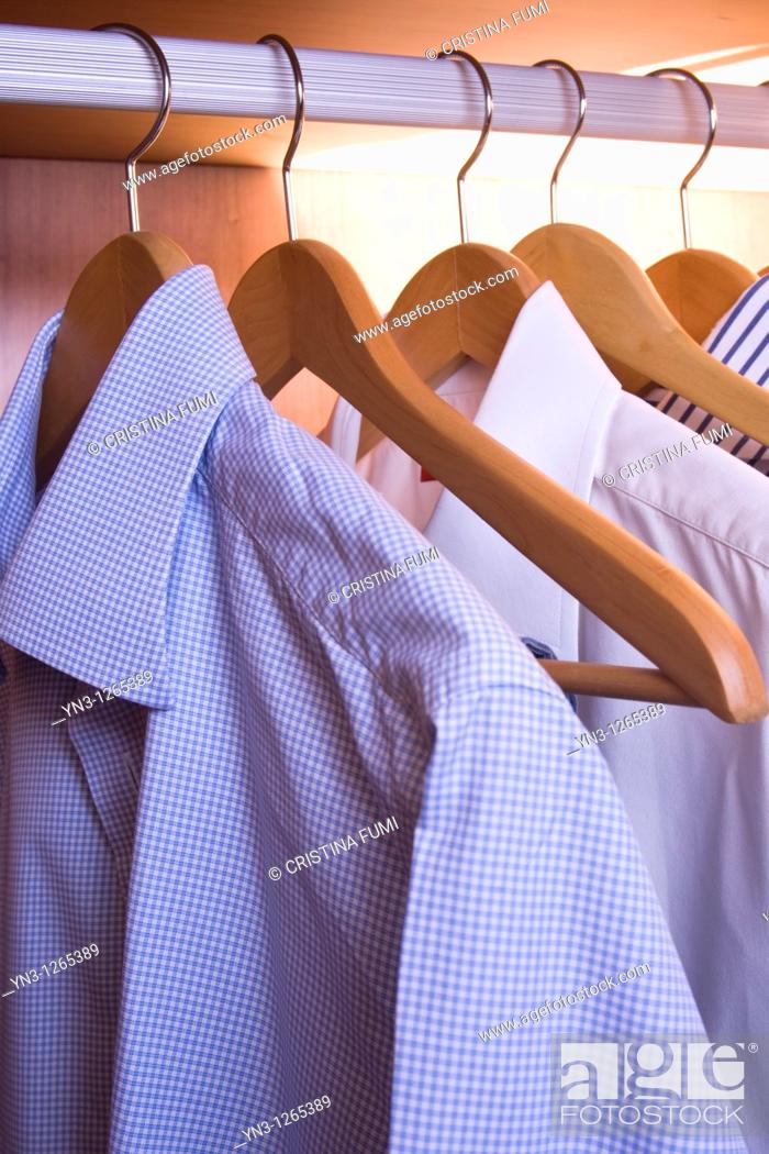 Stock Photo: Man's shirts in the closet.