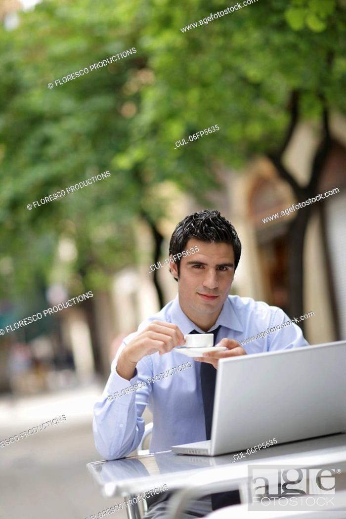 Stock Photo: Business man at café with laptop.