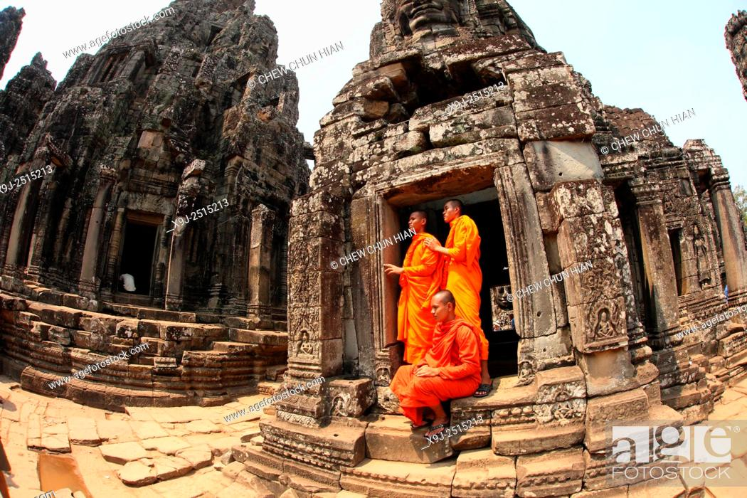 Stock Photo: Buddhist monks at Bayon temple, Angkor thom, UNESCO World Heritage Site, Siem Reap.