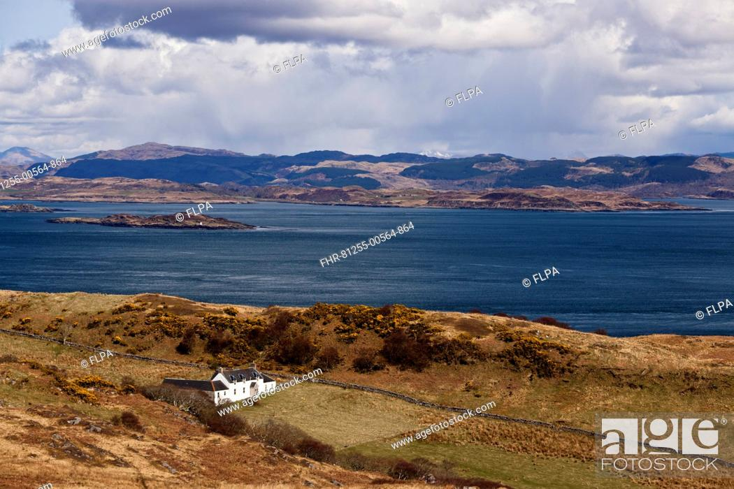 Stock Photo: View of coastline and remote farmhouse, former home of George Orwell where he wrote 'Nineteen Eighty-Four' novel, view across Sound of Jura to mainland.