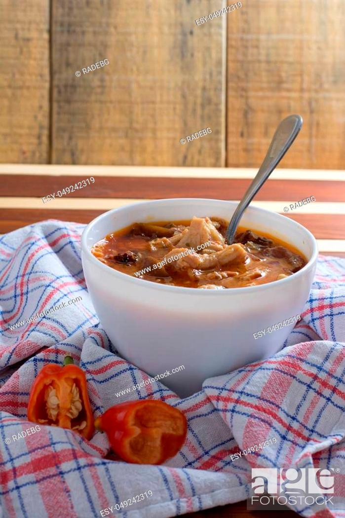 Stock Photo: Traditional and very popular serbian dish from beef tripe served on wooden table.