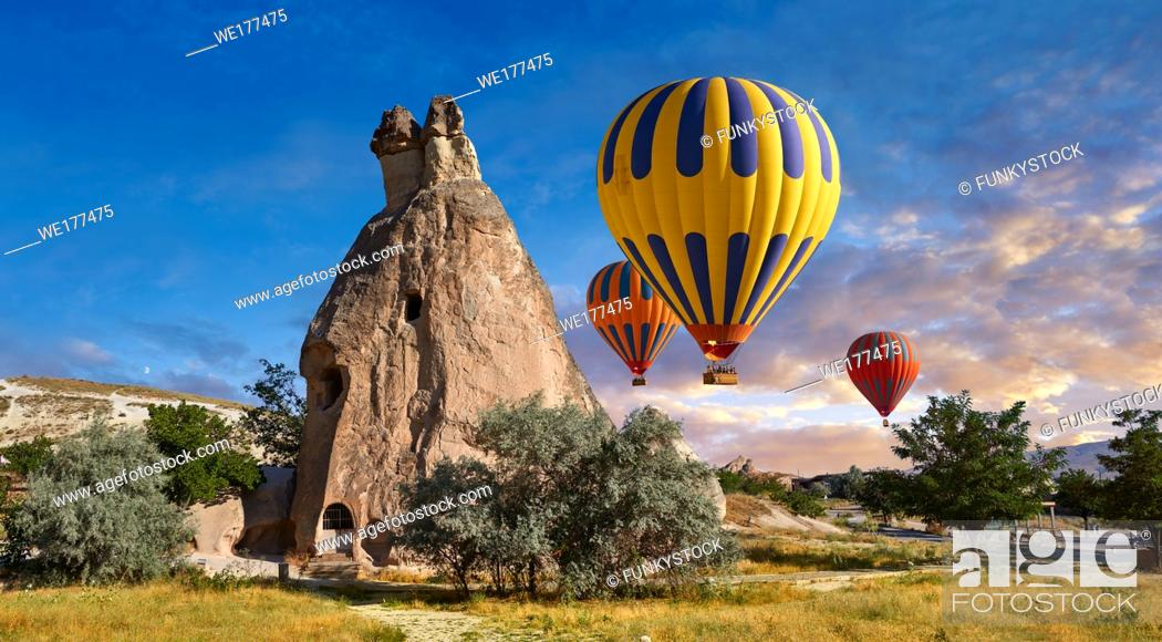 """Stock Photo: Pictures & images of hot air balloons over the fairy chimney rock formations and rock pillars of """"Pasaba Valley"""" near Goreme, Cappadocia, Nevsehir, Turkey."""