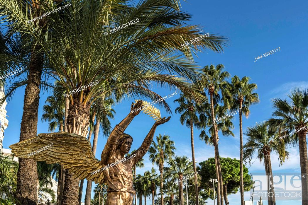 Stock Photo: Golden sculpture in front of Carlton Hotel, Palm tree, Cannes, Cote d'Azur, France,.