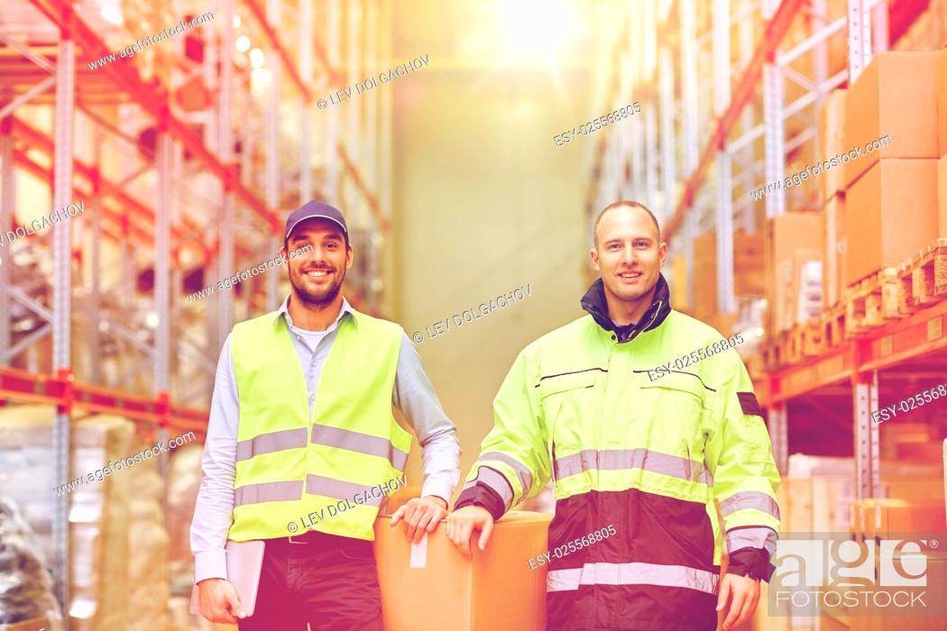 Stock Photo: logistic, delivery, shipment, people and export concept - happy men or manual workers with boxes at warehouse.