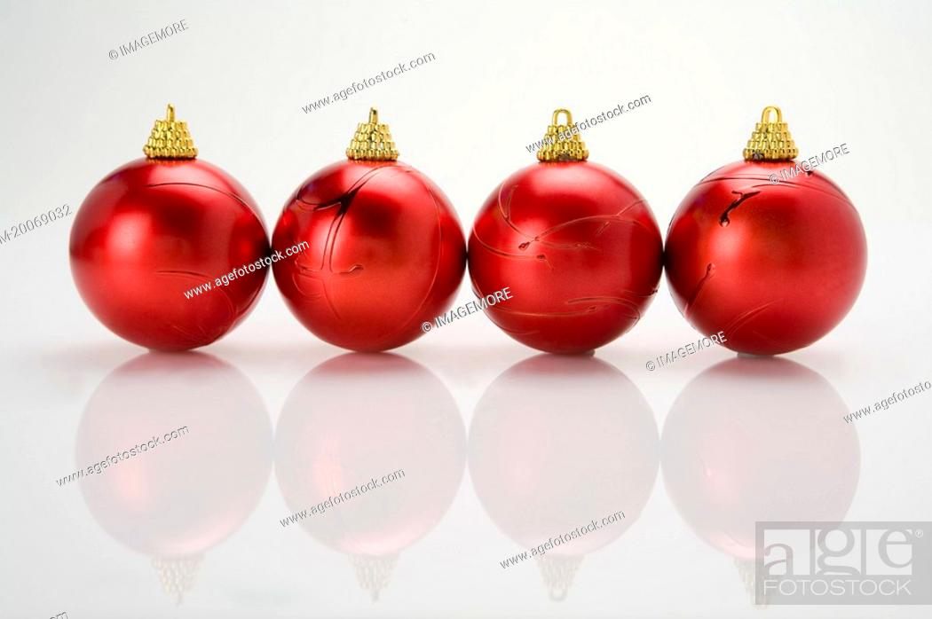 Stock Photo: Red Christmas baubles on a table.