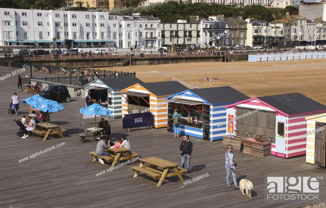 Stock Photo: Huts on Hastings pier East Sussex UK.