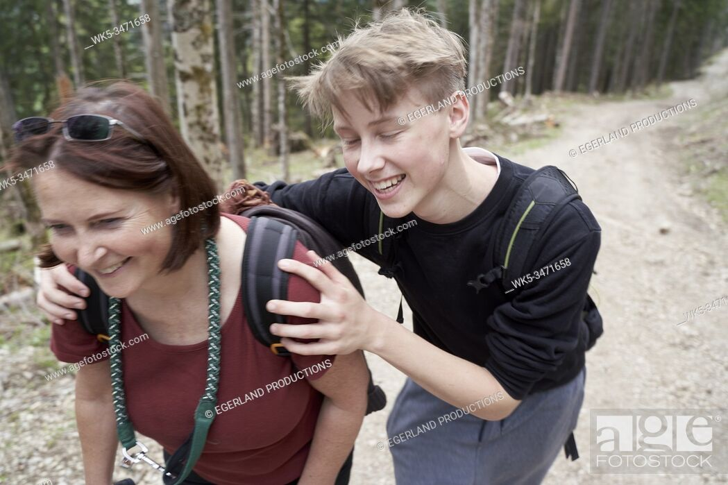 Stock Photo: Mature woman and teenager walking on a path in the forest. Bad Tölz, Upper bavaria, Germany.