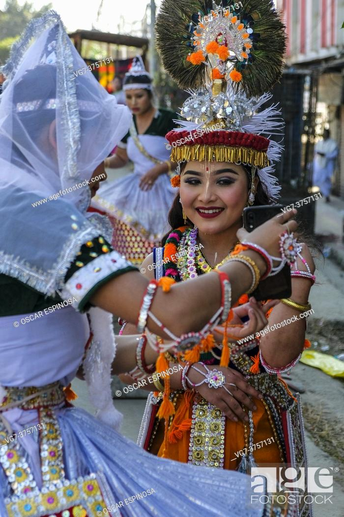 Stock Photo: Imphal, India - December 2020: Traditional dancers taking a selfie on a street in Imphal on December 27, 2020 in Manipur, India.