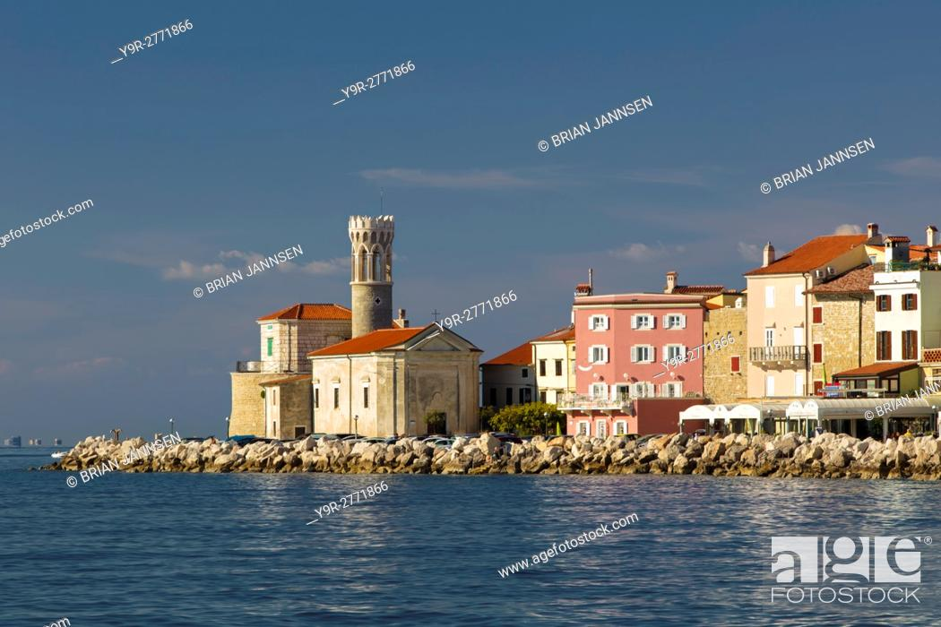 Stock Photo: Church of St Clement and buildings of Piran, Primorska, Slovenia.