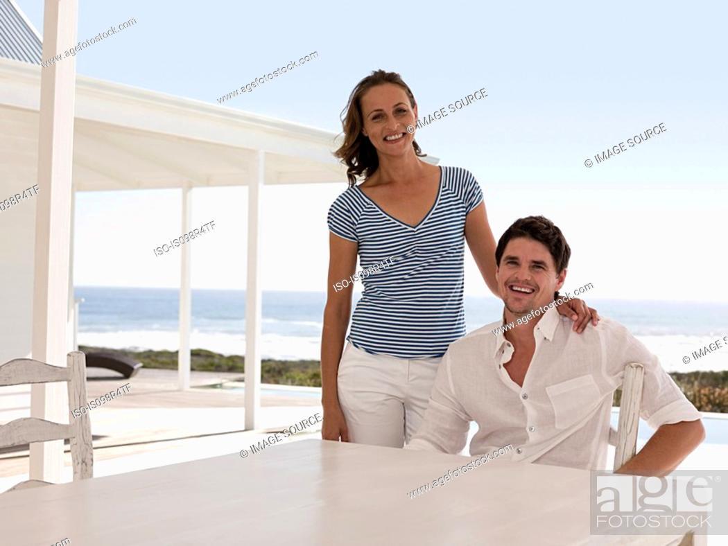 Stock Photo: Couple at beach house.