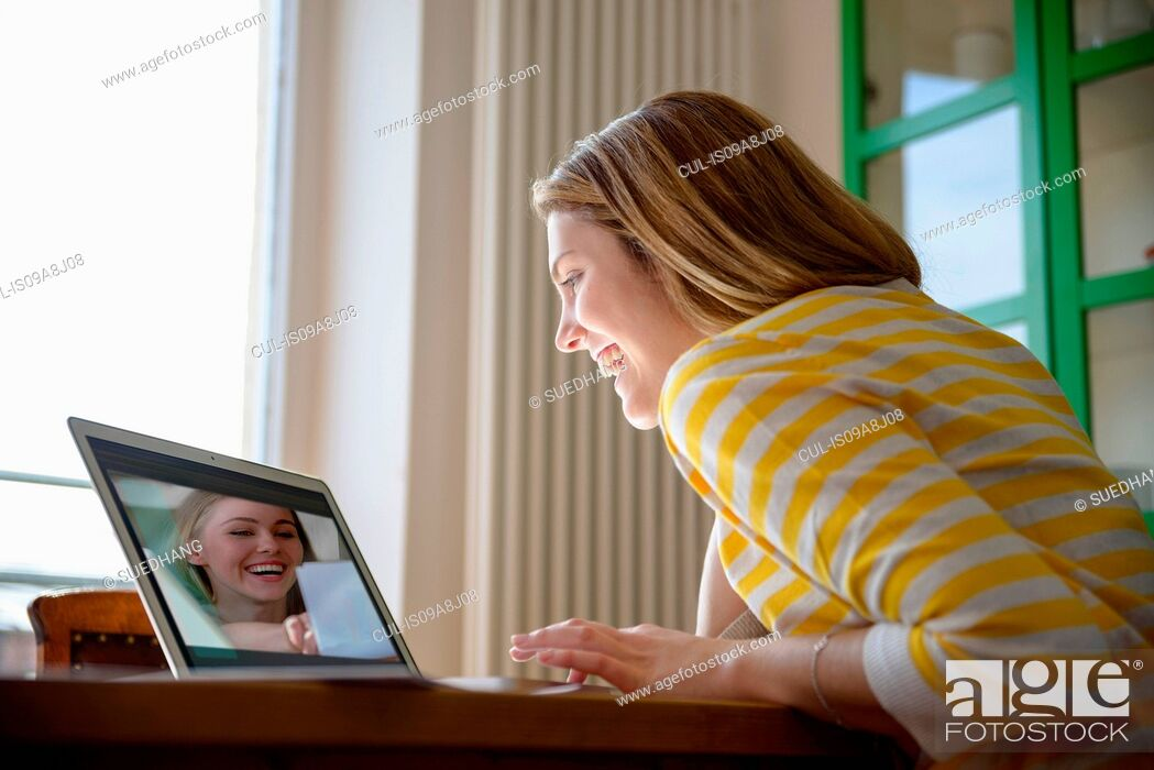 Stock Photo: Young woman on video call with friend.