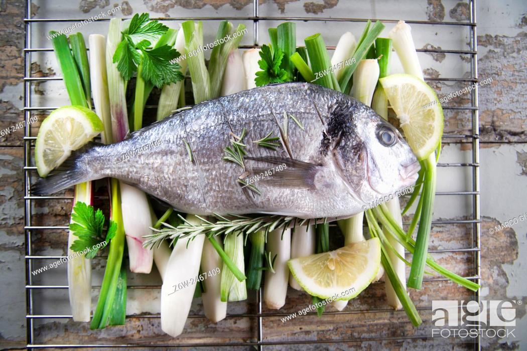 Stock Photo: Presentation and preparation of a second dish of sea bream and onions.
