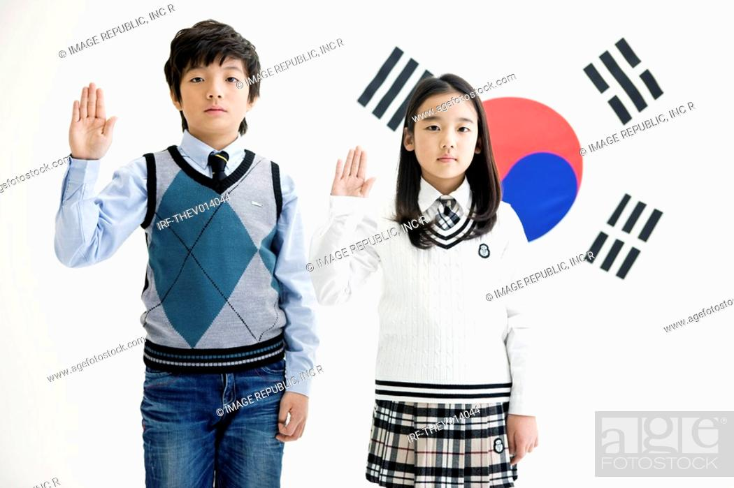 Stock Photo: boy and girl in front of Korean flag, Taegeukgi.