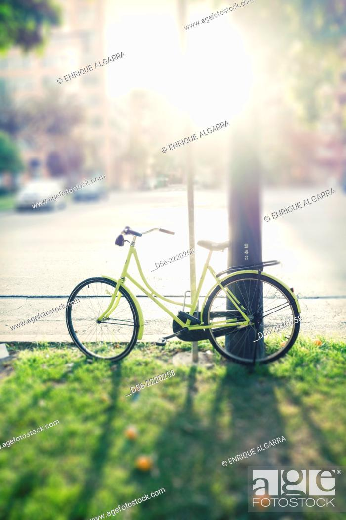 Stock Photo: Bicycle at sunset, Aragon avenue, Valencia, Spain.