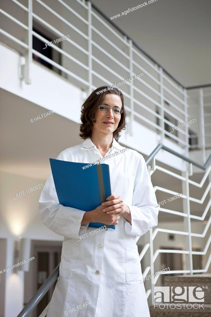 Stock Photo: Portrait of a doctor holding a file.