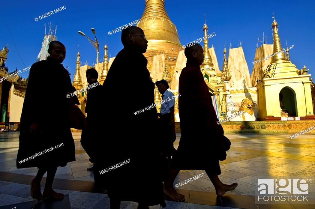 Stock Photo: Myanmar Burma, Yangon Division, Yangon, Singuttara hill, pilgrims inside the Shwedagon pagoda.