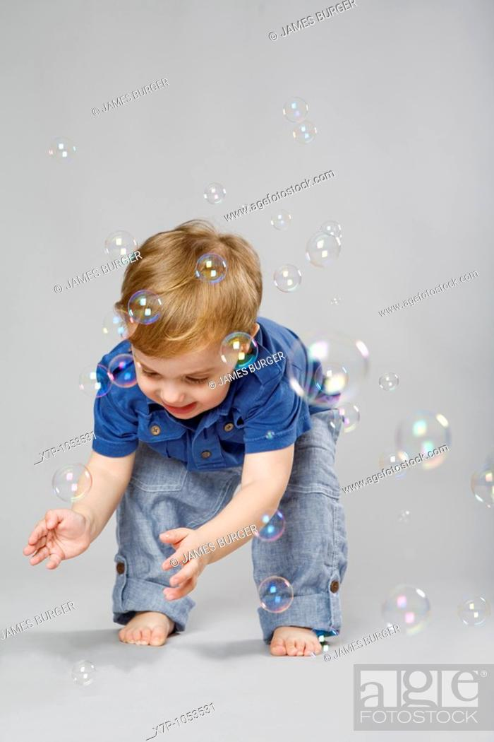 Stock Photo: 2 year old boy with bubbles.
