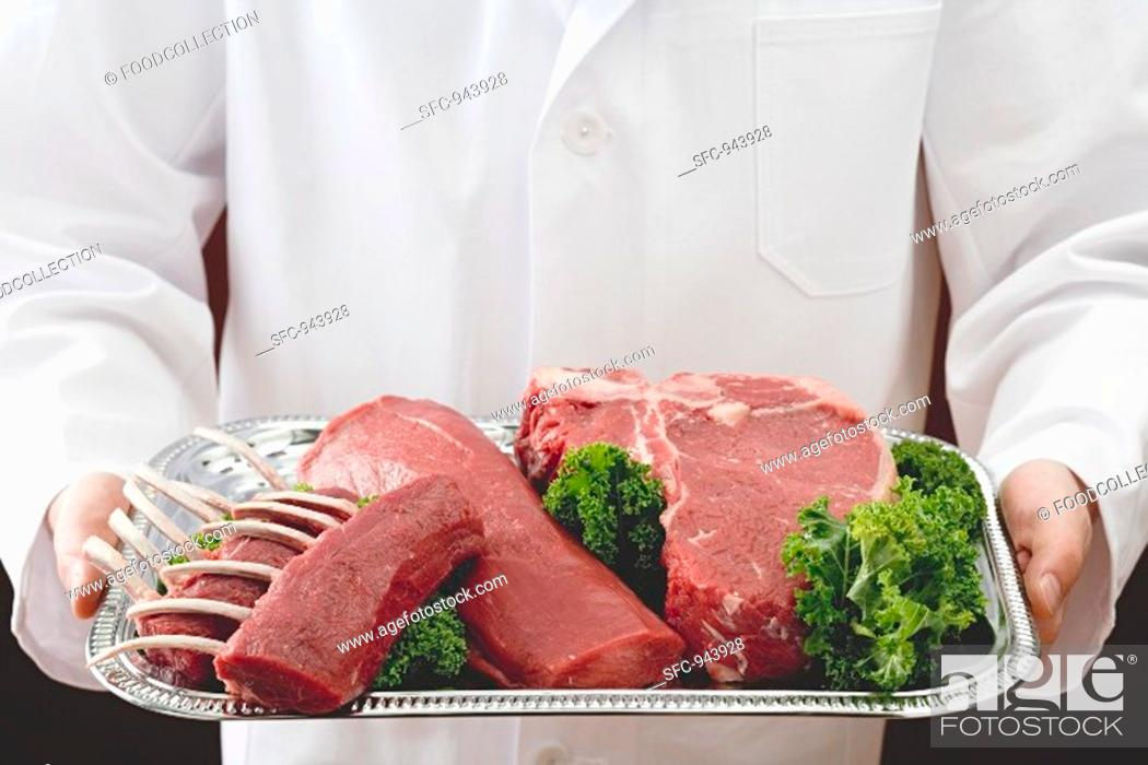 Stock Photo: Racks of lamb, beef fillet and T-bone steak.