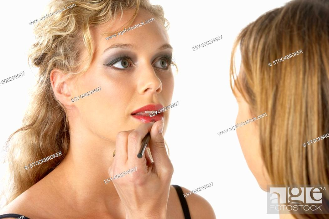 Stock Photo: Young Woman Having Her Lipstick Applied.