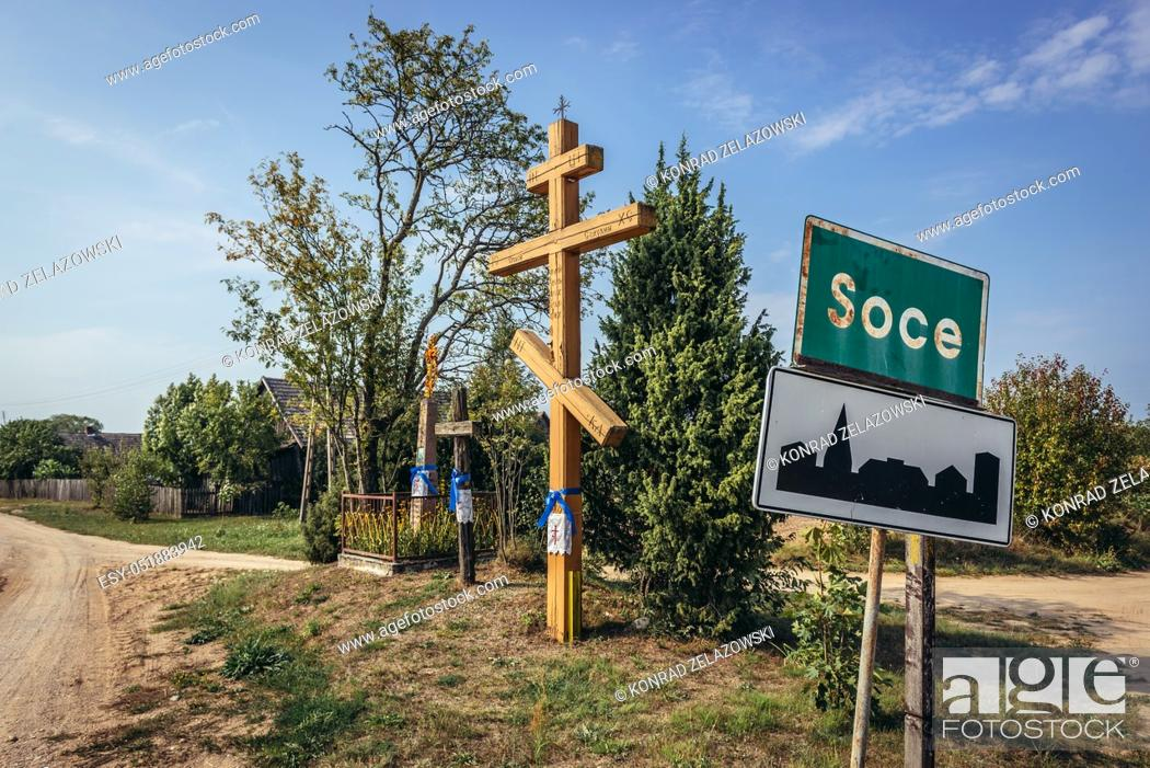 Stock Photo: Wayside cross in Soce village on so called The Land of Open Shutters trail, famous for traditional architecture in Podlaskie Voivodeship, Poland.