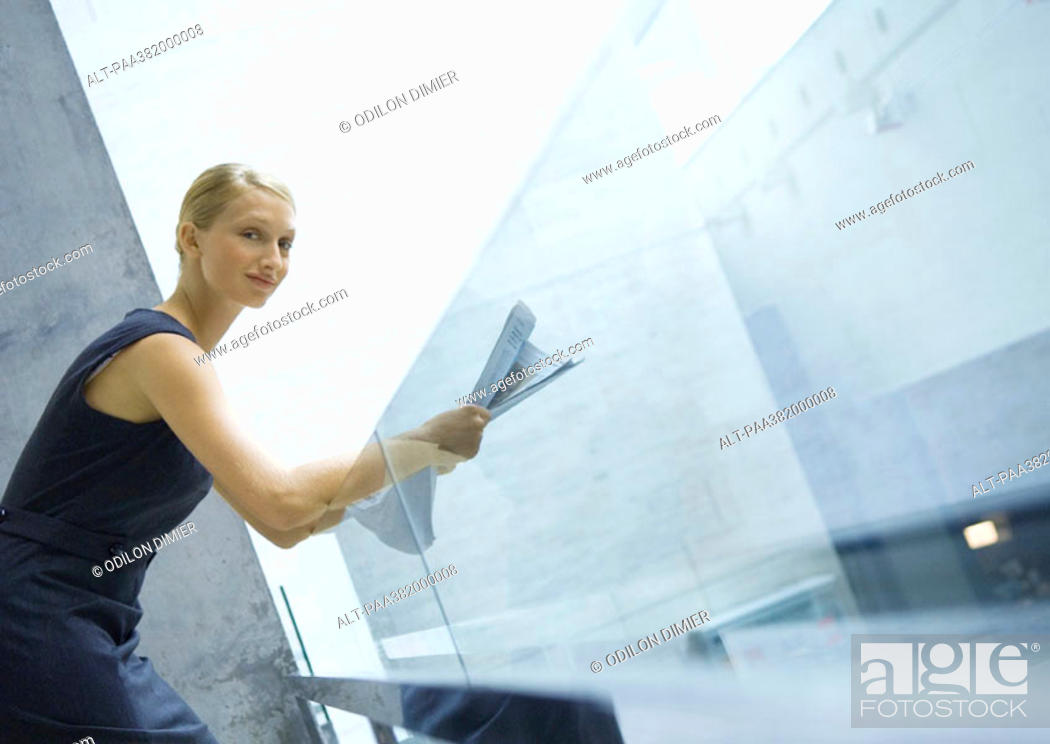 Stock Photo: Businesswoman reading newspaper.